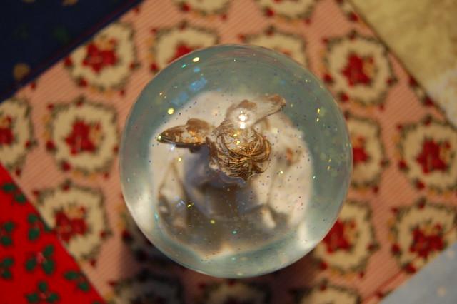 A small cute Snow globe angel (photo copyright Hanna Andersson, Studio iHanna)