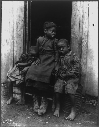 African American Girl with Two Younger Brothers