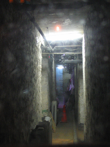 creepy basement tunnels through dirty window flickr