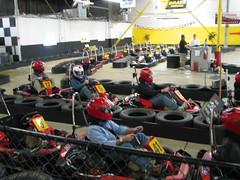 auto racing(0.0), sports(0.0), pit stop(0.0), formula one(0.0), go-kart(1.0), kart racing(1.0), racing(1.0), sport venue(1.0), vehicle(1.0), race(1.0), motorsport(1.0), race track(1.0),