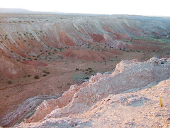 moraine(0.0), volcanic crater(0.0), cliff(0.0), canyon(1.0), soil(1.0), valley(1.0), formation(1.0), geology(1.0), plateau(1.0), terrain(1.0), wadi(1.0), badlands(1.0), rock(1.0),
