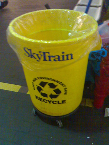 SkyTrain Yellow Recycle Bin