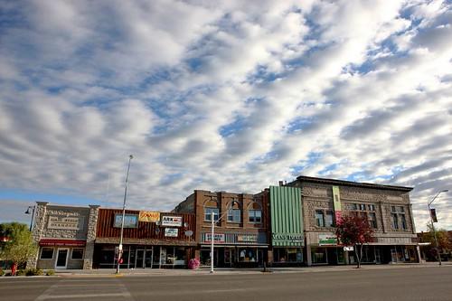 """Main street stores on a Sunday morning"" - Rexburg, ID"
