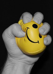 Hand holding stress ball. Middle Managers suffer stress as much as CEOs