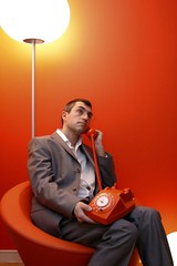 Man on rotary phone.