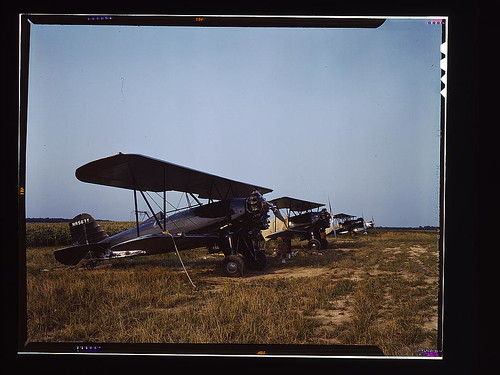 "Low flying planes from which dust or insecticide is spread onto crops by men who ""follow the season"" up the east coast, Seabrook Farm, Bridgeton, N.J. (LOC) by The Library of Congress"