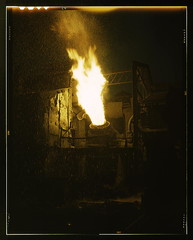A scene in a steel mill, Republic Steel, Youngstown, Ohio. Molten iron is blown in an Eastern Bessemer converter to change it to steel for war essentials  (LOC)