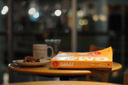 GMAT book on table in coffee shop.