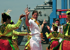 JAKARTA, Indonesia (May 25, 2011) Cmdr. Andree Bergmann, commanding officer of USS Howard (DDG 83), joins traditional Indonesian dancers celebrating her ship's arrival during Cooperation Afloat Readiness and Training (CARAT) Indonesia 2011. (U.S. Navy photo by Mass Communication Specialist First Class Robert Clowney)