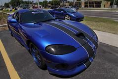 srt viper(0.0), race car(1.0), automobile(1.0), automotive exterior(1.0), wheel(1.0), vehicle(1.0), performance car(1.0), automotive design(1.0), chrysler viper gts-r(1.0), land vehicle(1.0), muscle car(1.0), supercar(1.0), sports car(1.0),