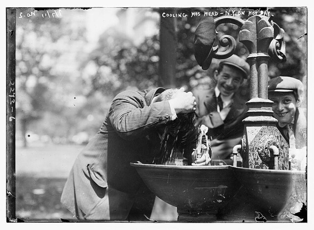 Cooling his head - N.Y. on hot day  (LOC)