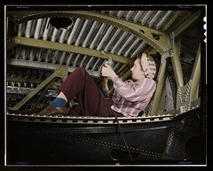 An A-20 bomber being riveted by a woman worker at the Douglas Aircraft Company plant at Long Beach, Calif.  (LOC)