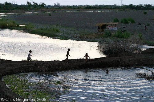 Children Playing in the Badoc River, the Philippines