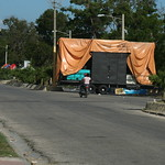 A sound system occupies half the dual carriageway of the main road through Barahona