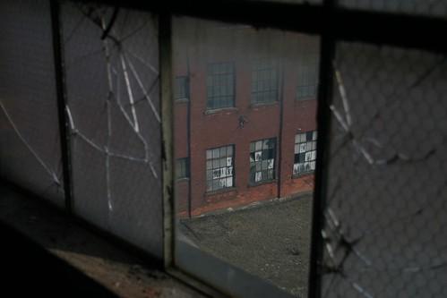 old windows urban building brick window spider wire decay bricks crack cracked chickenwire spidered