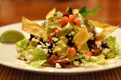 meal(0.0), taco(0.0), produce(0.0), guacamole(0.0), tuna salad(0.0), tostada(1.0), salad(1.0), food(1.0), dish(1.0), cuisine(1.0), caesar salad(1.0),