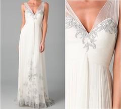 bridal clothing(0.0), sleeve(0.0), cocktail dress(0.0), satin(0.0), human body(0.0), bridesmaid(0.0), prom(0.0), bridal party dress(1.0), neck(1.0), textile(1.0), gown(1.0), clothing(1.0), woman(1.0), wedding dress(1.0), dress(1.0),