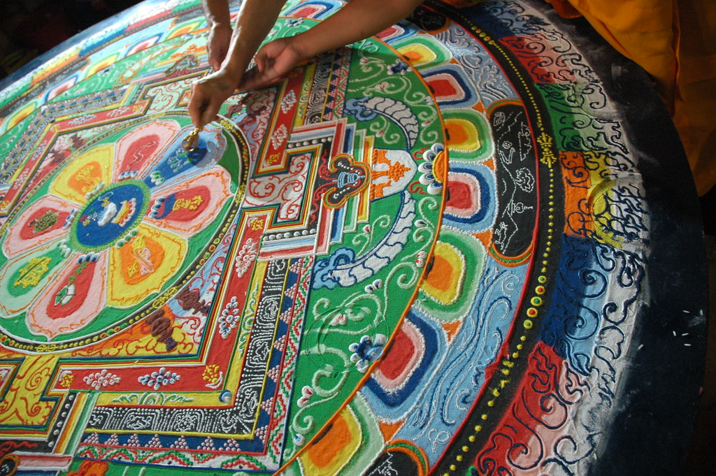 His Holiness Dagchen Rinpoche's hand holds a vajra drawing lines that close the Hevajra Mandala, after the empowerment, Tharlam Monastery, Boudha, Kathmandu, Nepal