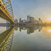 Sunrise below the Ft. Pitt Bridge in Pittsburgh along the Monongahela River by Dave DiCello