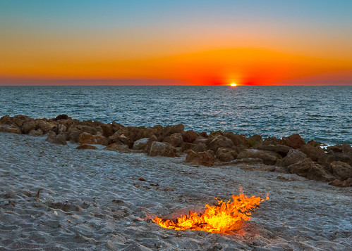 blue red orange sun gulfofmexico water yellow rocks waves sunsets 100v10f fav20 campfire beaches gf1 views800 views600 beachphotography cloudsstormssunsetssunrises sunsetmadness sunsetsniper caspersensbeach