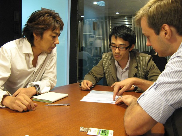 Kimachi, Hiro and Jeroen discussing Pepper Lunch layout