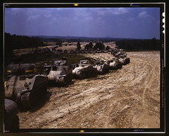 Parade of M-4 (General Sherman) and M-3 (General Grant) tanks in training maneuvers, Ft. Knox, Ky. Note the lower design of the M-4, the larger gun in the turret and the two hatches in front of the turret  (LOC)