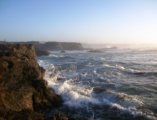 Surf and foam on the rocky shores of Glass Beach near sunset - glassbeach32