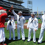 Washington Nationals mascot high fives one of the Sailors of the Year