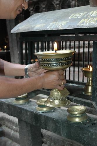 """Making a large Tibetan Buddhist butter lamp offering to Lord Buddha, Mahabuddha Temple, also known as """"temple of thousand buddhas"""", skikhar style buddhist temple, Kathmandu, Nepal by Wonderlane"""