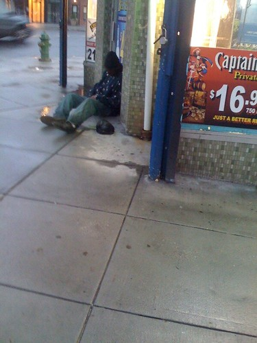 Guy sleeping in front of Liquor Store