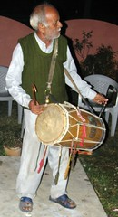 drummer(0.0), drums(0.0), barrel drum(0.0), drum(0.0), hand drum(0.0), percussion(1.0), dhol(1.0), skin-head percussion instrument(1.0),