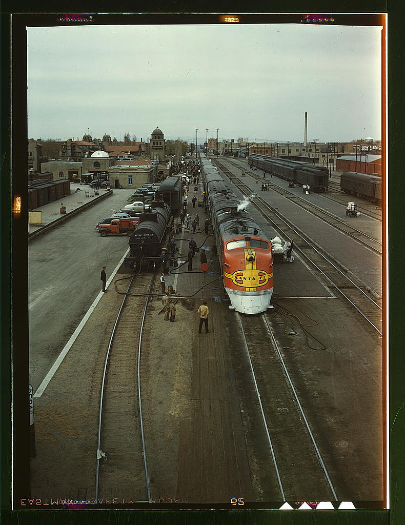 "Santa Fe R.R. streamliner, the ""Super Chief,"" being serviced at the depot, Albuquerque, N[ew] Mex[ico]. Servicing these diesel streamliners takes five minutes (LOC)"