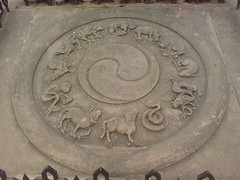 ancient history(0.0), temple(0.0), relief(0.0), manhole cover(0.0), carving(1.0), art(1.0), stone carving(1.0), manhole(1.0), circle(1.0),