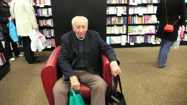 Dad relaxing in the book shop