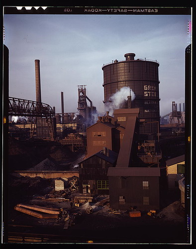 Hanna furnaces of the Great Lakes Steel Corporation, Detroit, Mich. General view showing tank which stores gas from the coke oven. Square building and extension in middle ground is where coal is fed to a feeder belt and then transferred to a storage place
