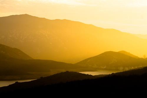 sunset sky sun clouds landscape outdoors silhouettes hills