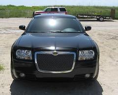 vehicle registration plate(0.0), automobile(1.0), automotive exterior(1.0), vehicle(1.0), mid-size car(1.0), chrysler 300(1.0), bumper(1.0), land vehicle(1.0), luxury vehicle(1.0),