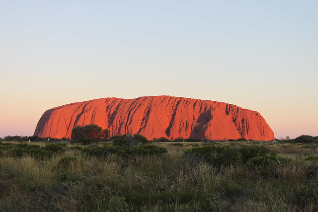 Uluru illuminated by the sunset