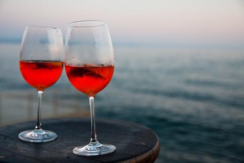 sunset sea glass table glasses evening coast mare wine croatia drop slovenia 1750 tamron f28 trieste aperitivo spritz adriaticsea miramare adriatico aperitif prosecco aperol barcola topolini spritzaperol