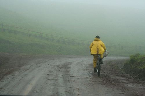 Bike rider in yellow raincoat