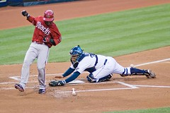 Justin Upton evades the tag by Josh Bard