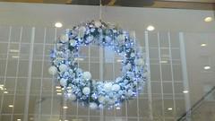 symmetry, light fixture, christmas decoration, glass, interior design, circle, wreath, blue, lighting,