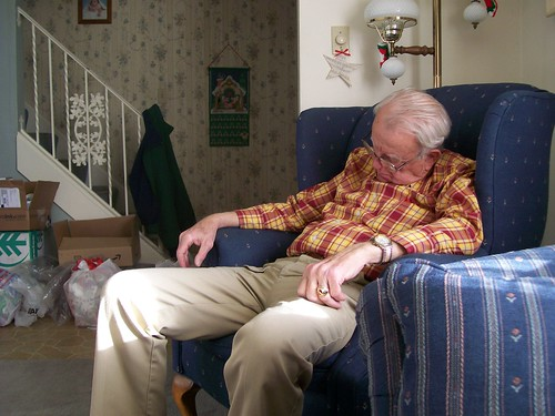 Old Man Sleeping In Chair