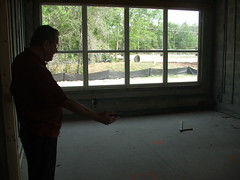 Father demonstrating something at the new home
