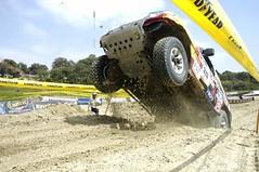 auto racing(0.0), monster truck(0.0), mud(0.0), automobile(1.0), racing(1.0), wheel(1.0), vehicle(1.0), sports(1.0), race(1.0), dirt track racing(1.0), off road racing(1.0), motorsport(1.0), off-roading(1.0), rally raid(1.0), off-road vehicle(1.0), race track(1.0),