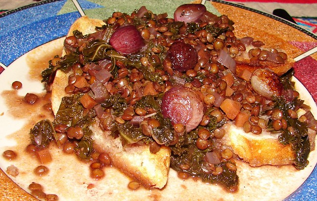 braised lentils with kale over toast, garnished with red pearl onions ...