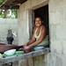 Woman washing dishes; Balfate, Colón, Honduras