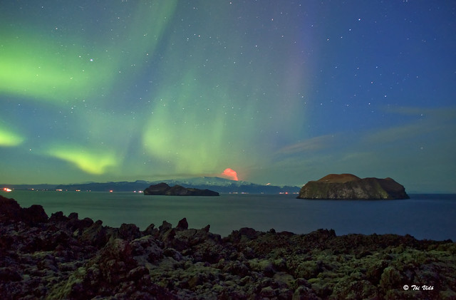 Northern lights   aurora  and volcanic eruption
