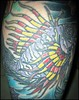 Left Calf Tattoo - Fish from the Love Canal Tattooing By Dave