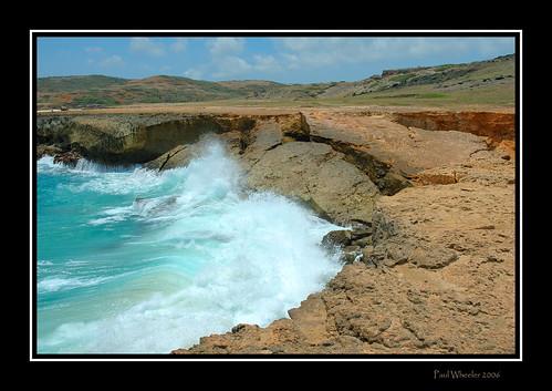 sea vacation seascape nature water landscape coast nikon rocks surf waves d70 framed scenic rocky aruba naturalbridge caribbean waterscape naturesfinest blueribbonwinner supershot